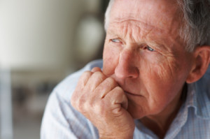 Closeup of an elderly man looking away in deep thought